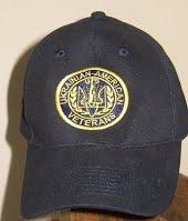 Dark blue baseball cap with Ukrainian American Veterans (UVA) emblem on front
