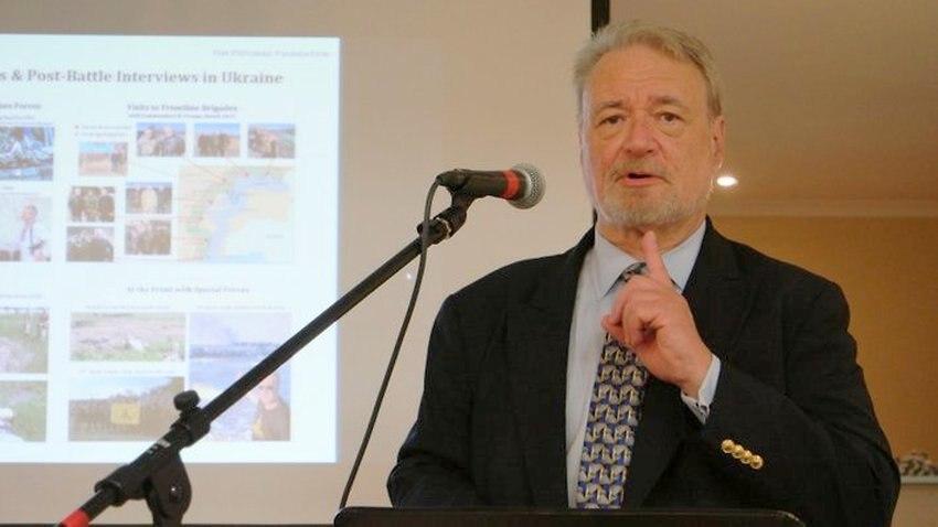 Phillip Karber speaking at lectern