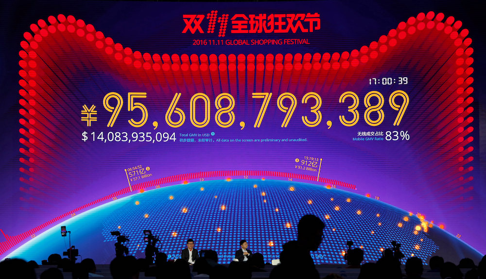 A screen shows value of goods being transacted at Alibaba Group's 11.11 Singles' Day global shopping festival in Shenzhen