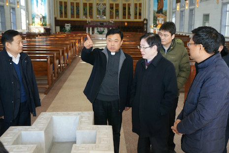 <p>Father Ding Lingbin, bishop candidate of Changzhi Diocese, second left, shows Wang Zuoan, third left, director of the State Administration for Religious Affairs, his church in December 2014. (Photo supplied)</p>