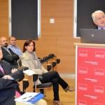 Antonio García, entre el público, junto a Juan Emilio Feliu durante su intervención