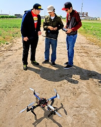 Graduate student Tiebiao Zhao, center, and other students work on precision agriculture projects.