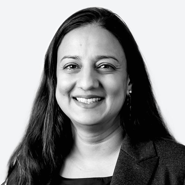Black and white portrait of Nisha Parikh.
