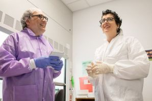 two people talk in a lab