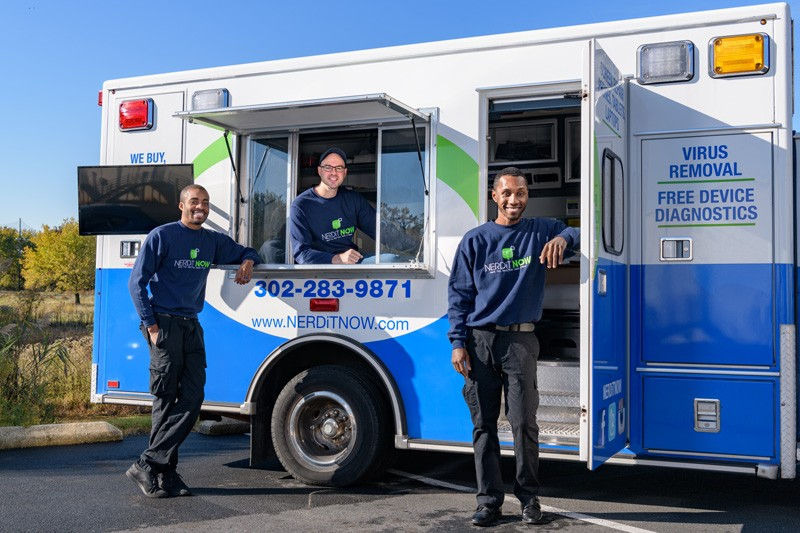 "Left to right, Markevis Gideon, Jake Voorhees and Jonathan Hoxter, who run NerdiT Now, stand in front of their retrofitted ambulance, affectionately called ""The Motherboard."""