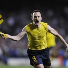 Celebration time for Barcelona's Andrés Iniesta after his dramatic late strike