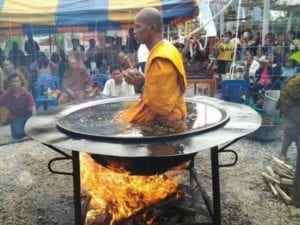 monk meditates in a pot of boiling oil on fire