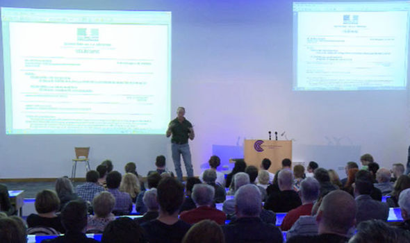 "Steven Greer reveals his ""French MoD document"" to the crowd! (Picture courtesy of Steven Greer and the Daily Express)."