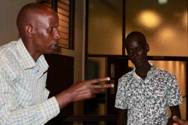 Joseph Nkunda, left, with his son, a child sacrifice survivor