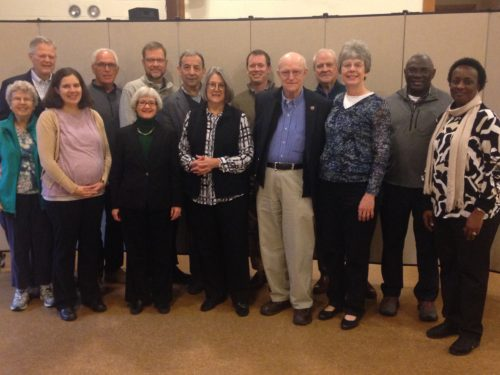 Senyonyi's, at right, with UCU Partners Board and some spouses at a meeting in Boston, Massachusetts.