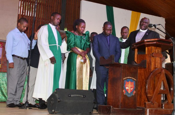 Rev. Amos Kirmera and his wife, Florence, receive prayers from UCU's vice chancellor and priests during an Aug. 25 church service on the Mukono, Uganda. The family has been chosen to serve a minimum of two years in Massachusetts. (UCU Partners photo)