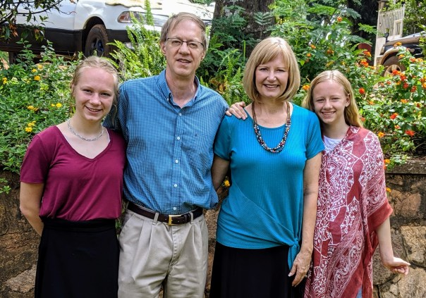 Fulbright Professor David Hodge with wife and daughters on the Uganda Christian University, Mukono, campus