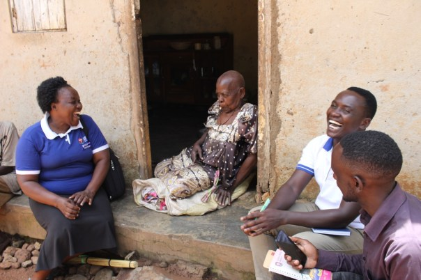 Elizabeth Nagudi Situma, left, UCU Head of Nursing, and students meet with Magdalene Nayonjo, a community resident