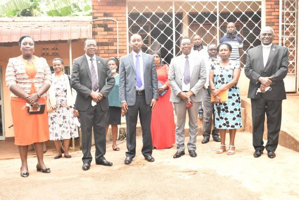 Outgoing Uganda Christian University (UCU) Vice Chancellor, John Senyonyi (right front) poses recently with some of his leadership team, including the Mayor of Mukono, George Fred Kagimu (third from right); and the incoming Vice Chancellor, Aaron Mushengyezi (third from left).