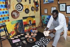 Kelvin Kambere exhibiting his art