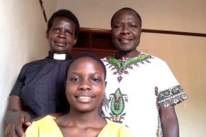 John Livingstone Mutyaba with his wife and daughter