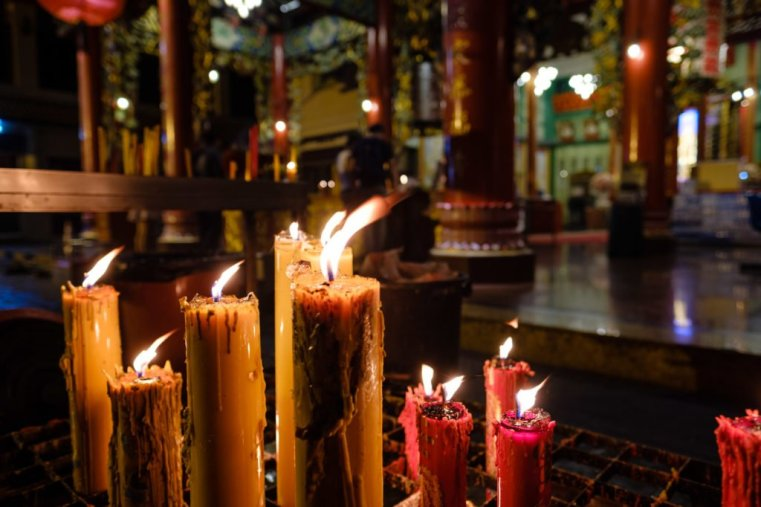 Candles burning in a Chinese temple. Chinatown, Bangkok