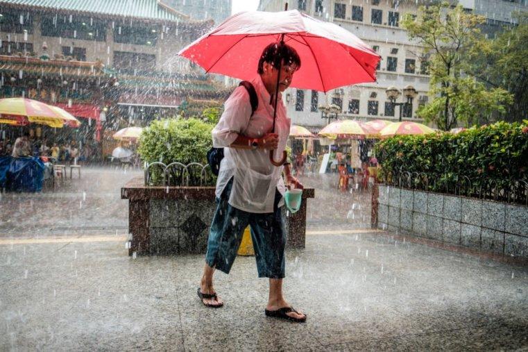 Seeking shelter from the rain, Waterloo St., Singapore