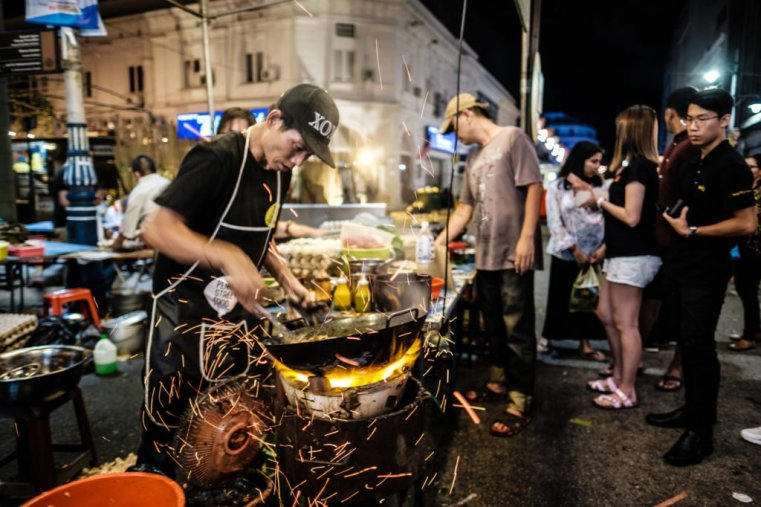 Making char kuey teow on the street, Penang, Malaysia