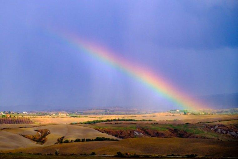 Rainbow over Tuscany's countryside, Italy