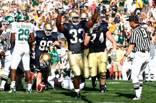 Robert Hughes celebrates his first career touchdown in the 2007 Michigan State game.  There was a time when celebrations like this were commonplace against MSU.  (Photo - Icon SMI)