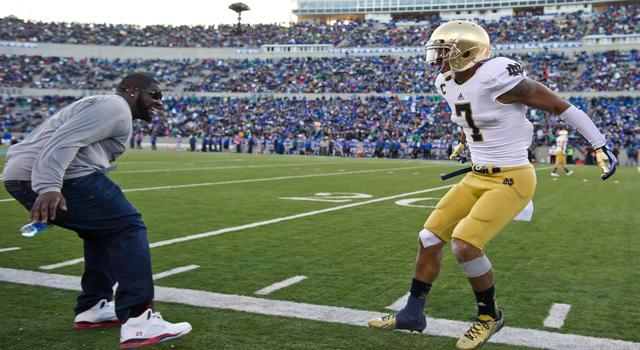 Oct 26, 2013; Colorado Springs, CO, USA; Notre Dame Fighting Irish wide receiver TJ Jones (7) celebrates with former player Kapron Lewis-Moore (left) after Jones scored a touchdown in the third quarter against the Air Force Falcons at Falcon Stadium. Notre Dame won 45-10. Mandatory Credit: Matt Cashore-USA TODAY Sports