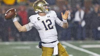 Notre Dame Quarterback Ian Book attempting a pass versus Michigan