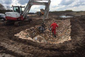 Cascade van breuksteen in beton Lange Matenloop – Aannemingsbedrijf M.J. van Uijtert en Zn. -