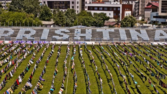 Alketa Xhafa-Mripa's art installation of 5,000 skirts and dresses stretched on clotheslines across a football pitch in Kosovo's capital Pristina. Alketa is a Kosovo-born British artist whose work often deals with sexual violence.