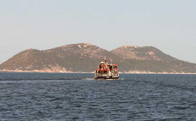 A tourist boat heads to the island of Sazan, some 140 km southwest of Albania's capital Tirana, on July 31, 2015. (Agence France-Presse)