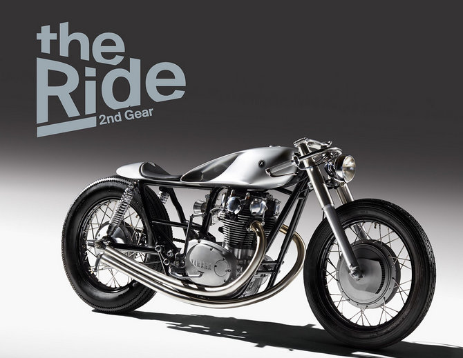 "A custom made motorcycle designed and build by two British-Albanian industrial designers, Gazmend dhe Bujar Muharremi, has made it onto the front cover of the ""The Ride 2nd Gear"" book."