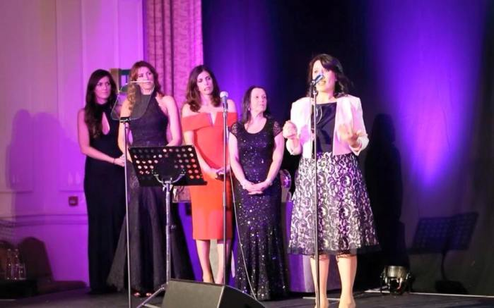 "Mirela Sula delivering a speech after accepting the award from ""Inspiration Awards For Women 2015"""