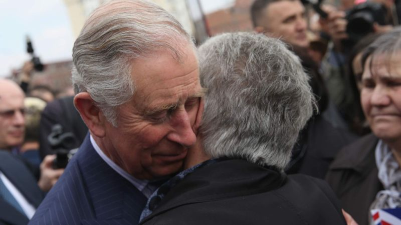 The Prince of Wales hugs the families of Kosovo Albanian people missing since the 1999 War