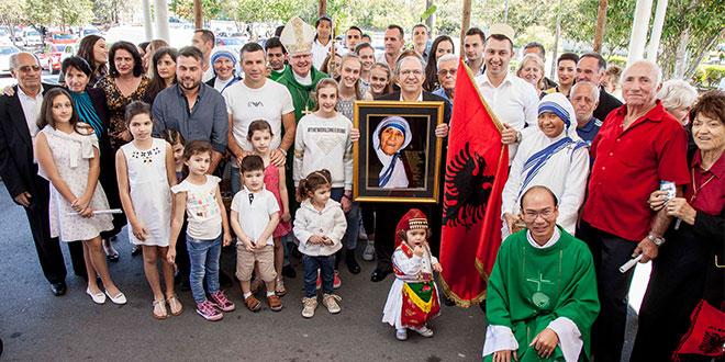 Celebration day: Brisbane Archbishop Mark Coleridge with the Albanian Community at the celebration of the Canonisation of Mother Teresa of Calcutta at the St Maximilian Kolbe Catholic Parish, Marsden. Photos: Alan Edgecomb