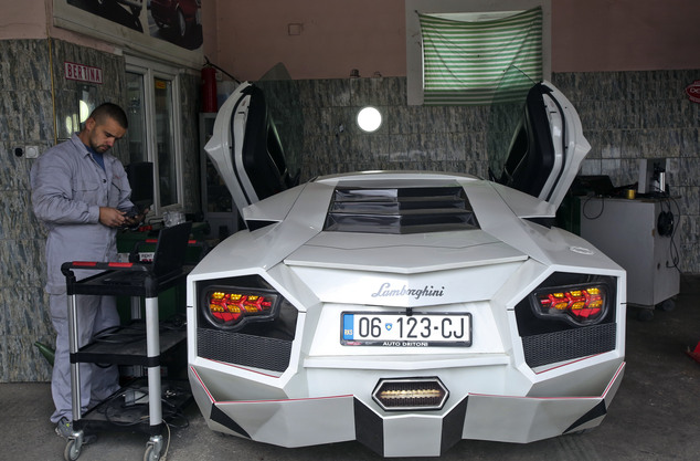 Kosovo car enthusiast Driton Selmani works on his hand made replica of a Lamborghini in his workshop in the town of Gjilan on Thursday, Oct. 27, 2016. Selmani always wanted some hot wheels but could not afford them. What he had, however, was a workshop and talent for bending and welding metal. so he built himself a Lamborghini. (AP Photo/Visar Kryeziu)