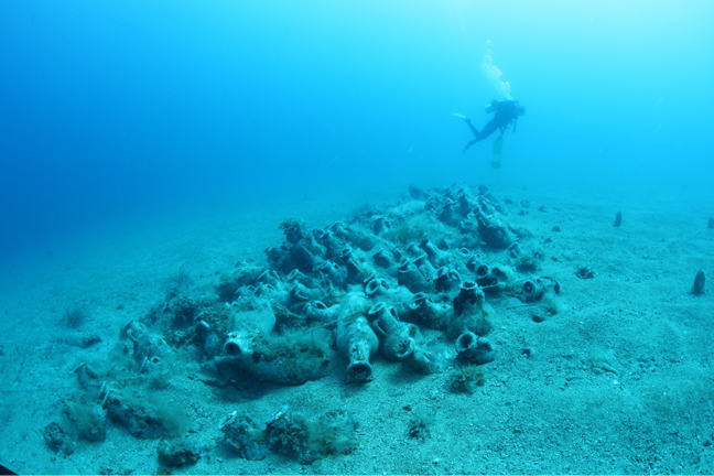 A diver swims over the 4th century AD Joni shipwreck in Albania. Resting in the shape of the ship, the wreck is composed of stacks of North African amphoras which indicate valuable trade between Carthage (Tunisia) and Adriatic cities in Roman times. © University of Southampton, 2016