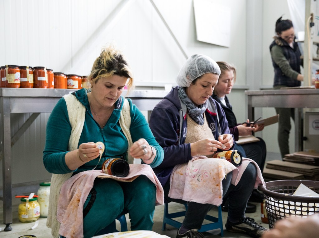 Women, most of them widows, work in the factory, labeling pepper jars by hand. Valerie Plesch