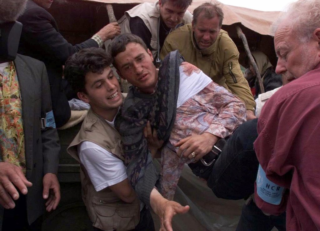 A wounded ethnic Albanian refugee from Kosovo is unloaded from his tractor trailer after entering Albania from Kosovo at the Morini border crossing Tuesday, May 4, 1999. More than 675,000 ethnic Albanians have poured out of Kosovo since the NATO airstrikes began on March 24, many say they were forced out by roving bands of Serbs and are alleging mass atrocities. Thousands more refugees streamed out to Albania and Macedonia on Monday.