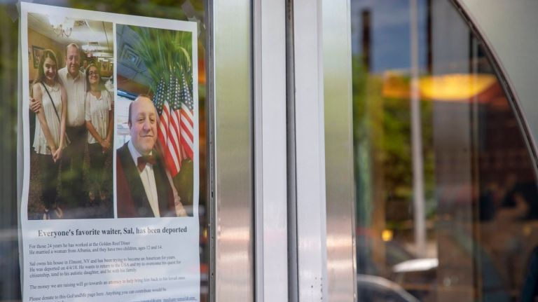 "A poster that hangs in the window shows two photos of ""Sal"" and publicizes a GoFundMe campaign created by customers to help defray his legal fees and other expenses."