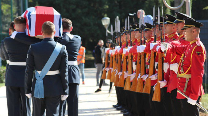 A coffin passes the Albanian Guard of Honour