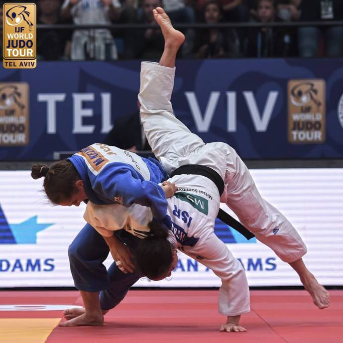 Force to be reckoned with: Olympic Champion Majlinda Kelmendi of Kosovo demolished her way to the -52kg final where she took gold after defeating Israel's Gili Cohen