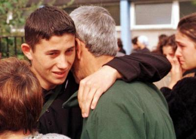 Hugs from one of the Kosovar refugees as he says farewell to Ulverston friends and helpers in August 1999.