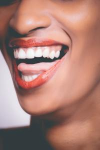 dark skinned woman with white teeth and red lips