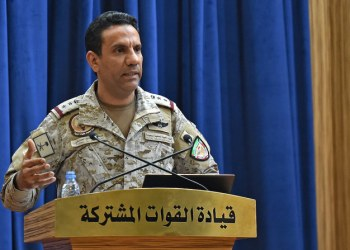 Spokesman of the Saudi-led military coalition Colonel Turki al-Maliki gestures during a press conference in the Saudi capital Riyadh, on September 16, 2019. - The weapons used to strike two Saudi oil plants were provided by the kingdom's arch-foe Iran, the spokesman of the Riyadh-led coalition fighting in Yemen said. The Tehran-backed Huthi rebels in Yemen, where a coalition is bogged down in a five-year war, claimed the September 14 strikes on two facilities in Saudi Arabia, owned by state energy giant Aramco, which sent shock waves across oil markets. (Photo by Fayez Nureldine / AFP)
