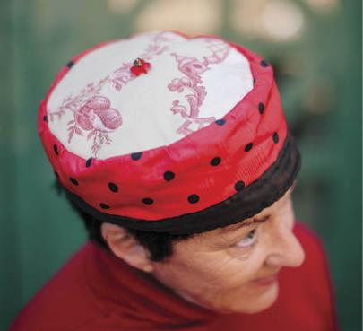 Dale Evje, uke enthusiast, shows off the hat she made