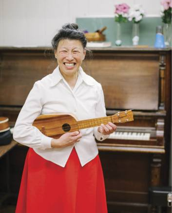 Stephanie Jeong gleems with joy as she shows off her Kamaka at the Ukulele Club of Chinatown in San Francisco
