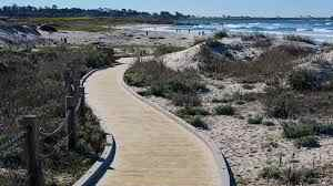 A short boardwalk stroll takes you to the beautiful Asilomar State Beach.