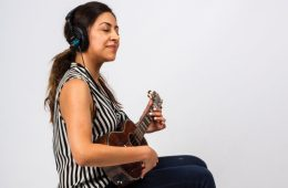 Woman Playing Ukulele Magazine for Get Off the Page and Play by Ear ukulele lesson