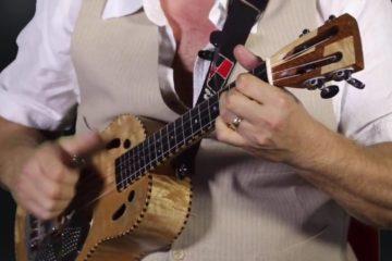 li'l rev holding a ukulele for clawhammer ukulele lesson