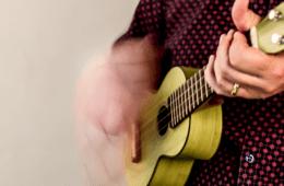 yellow ukulele strumming
